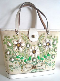 Enid Collins jewel embossed handbag. My grandmother had at least 30 or more of these bags. She liked a little glitz..here and there:)