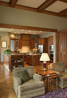 Light oak cabinets and trim, lighter green walls for kitchen and general living area