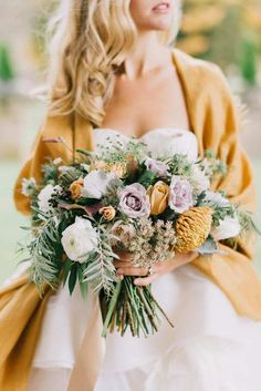 whimsical bouquet with pale yellow and purple flowers + greenery