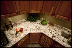 Bianco Antico Granite with medium-dark cabinets. Updated Kitchen, New Kitchen, Kitchen Dining, Kitchen Decor, Kitchen Ideas, Small Space Kitchen, Kitchen On A Budget, Granite Kitchen, Granite Countertops