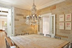 absolutely LOVE this! I love the rough brick/limestone, hardwoods, and the chandelier!
