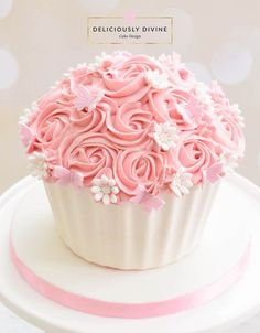 A cake smash giant cupcake for a girls 1st birthday. Sweet, pretty and pink topic with a white chocolate shell.