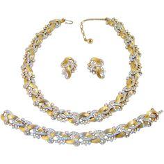 Vintage Trifari Necklace Bracelet Earrings Rhinestones Golden Swirls from The Vintage Carousel on Ruby Lane