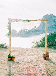 Beautiful wedding arch overlooking Es Vedra, Ibiza #ibizawedding #ibizaweddingideas #ibizaweddinghair #ibizabrides #weddingmakeup #bridalmakeup #ibizastyle #bridesibiza #makeupartistibiza #marieducharclark