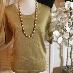 Ann Taylor fancy top Elegance and quality in a top , made of acetate, nylon and metallic , it could fit a large size as well , excellent condition Ann Taylor Tops Blouses