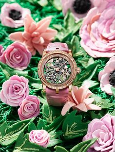 - <b>Roger Dubuis Excalibur Brocéliande Pink gold</b> – Case pink gold – Bezel set with 60 brilliant–cut diamonds approx. 1.09 cts – Crown set with 1 rose–cut diamond approx. 0.42 ct – Dial: Skeleton with Ivy ornaments set with 58 brilliant–cut diamonds approx. 0.15 cts – and white mother–of–pearl – Pink gold flange set with 157 brilliant–cut diamonds approx. 0.91 cts