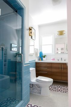 Blue retro tile, walnut cabinetry, vintage touches // Modern Mash-Up Bathroom in a Bright Echo Park Bungalow