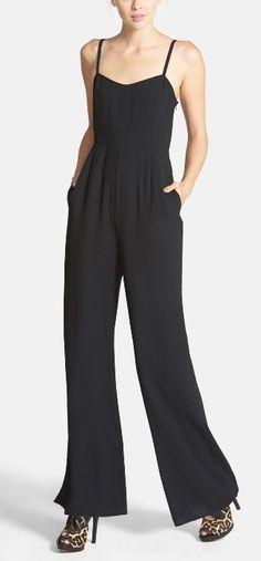 Try this jumpsuit with an over-sized chunky sweater, statement necklace and fun flats.