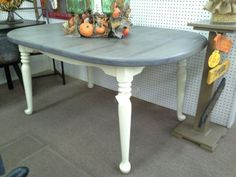 $129 - This dining table has a grey wash table top and creamy white legs. Measuring approximately 60x39, no leaf. It can be seen in booth B 9 at Main Street Antique Mall 7260 East Main St ( E of Power Rd ) Mesa 85207  480 9241122 open 7 days 10 till 530 Cash or charge 30 day layaway also available