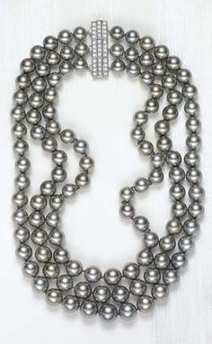 PHILLIPS : NY060110, A Three-Strand Black Tahitian Cultured Pearl and Diamond Necklace