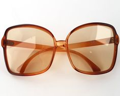 Vintage extravagant sunglasses. In very good vintage condition. Minimal signs of age and use.  The lenses are without diopters. Dimensions: front of frame 140 mm (5.51) hinge to hinge 138 mm (5.43) bridge 18 mm (0.71) lens 58mm x 58 mm (2.28 x 2.28)   ******************************************************************************  Please do not hesitate to contact for any further details.  Also please check the shop policies. This will help to avoid any misunderstanding in communication…