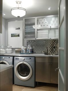 The laundry room attached to that mudroom by Sarah Richardson Design. Cute, however not my dream laundry room. Laundry Room Art, Modern Laundry Rooms, Laundry Room Design, Laundry In Bathroom, Laundry Area, Small Laundry, Basement Laundry, Laundry Storage, Organized Basement