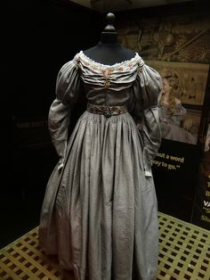 A dress worn by Amanda Seyfried as Cosette, in the film adaption of the Broadway musical Les Miserables, based on the novel by Victor Hugo. Costume design by Paco Delgado.