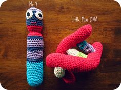 Biology-related crocheted baby rattles! Mr Y chromosome - inspired by http://knithacker.com/2013/03/10/cecilia-espinozas-crochet-chromosome-7/ Little Miss DNA - pattern - http://nadinespatterns.blogspot.co.nz/2008/05/dna-model-crochet-w-link-to-knit.html