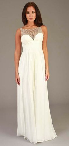 This ravishing Aidan Mattox gown is perfect for a destination wedding or for a second wedding dress. This simple yet elegant dress features a ruched empire waistline, slight padding in the cups, and a back hidden zip. The neckline on this dress is incredible as it has a sweetheart neckline, but mesh with silver sequins cover the rest of it so the neckline now becomes a slight scoop neckline.    Color: Ivory  Fabric: 100% silk   $65.00