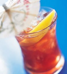 """Mai Tai translates as """"out of this world."""" For summer parties on patio or deck, serve this other worldly sweet rum, Cointreau, and pineapple juice cocktail with a platter of appetizers."""