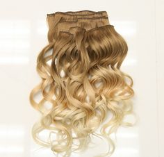 """New! Ombre clip in hair extensions now available! 7 wefts, 20 """" length. These have been curled, but the extensions come straight.  http://leylamilanihair.com/collections/ombre #clipin #hairextensions #ombre"""
