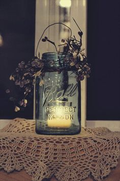 Decor for wedding. Love the mason jar and candle idea and just add some flowers that go with the colors of your wedding.