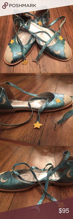 Anna Sui Star Moon Lace Up Flats Super cute all leather and metallic blue lace up flats with leather patches shaped in stars, moons and clouds by Anna Sui. The left shoe is missing one of its lace-up strings, as pictured. Italian leather! Anna Sui Shoes Flats & Loafers