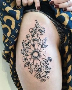 10 Beautiful Flower Tattoo Ideas for Women: #2. BLACK INK FLORAL THIGH TATTOO