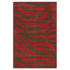 Hand-tufted wool rug with an animal print motif.  Product: RugConstruction Material: 100% WoolColor: RedFeatures: Hand-tufted Note: Please be aware that actual colors may vary from those shown on your screen. Accent rugs may also not show the entire pattern that the corresponding area rugs have.Cleaning and Care: These rugs can be spot treated with a mild detergent and water. Professional cleaning is recommended if necessary.