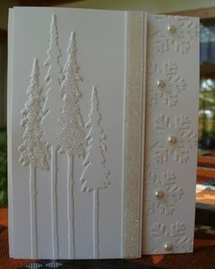 I CASED this card for my 2012 Christmas Card - Couldn't find Velvet ribbon, used Grossgrain. Didn't have that border punch, used a snowflake ribbon punch, cut the front flap off at the ribbon & attached the snow flakes to the inside.