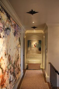 Great way to make a small dark hallway look larger.  Interior painting of hallway.