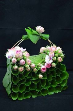 Do you think this would make a cool flower girl petal holder if we opened up a hole for the petals? Deco Floral, Arte Floral, Floral Design, Ikebana, Flower Bag, Flower Show, Creative Flower Arrangements, Floral Arrangements, Unusual Flowers