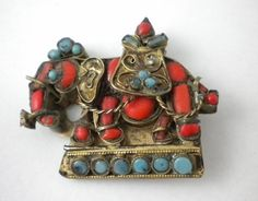 Vintage CORAL & TURQUOISE CABOCHONS IN BRASS ELEPHANT BROOCH