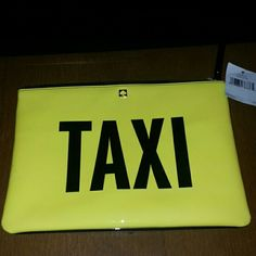"""Nwt neon yellow and black kate spade clutch. Nwt neon yellow and black kate spade clutch. One side features """"taxi"""" the other states """"off duty"""".   Small blenish on the side (see 3rd photo).   Authentic. kate spade Bags Clutches & Wristlets"""