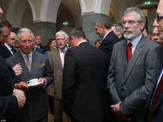 Anticipation: The Prince of Wales (left) before shaking hands with Sinn Fein president Gerry Adams (right) at the National University of Ireland in Galway