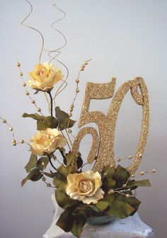 50th centerpieces with pictures, roses and cutouts | www.DesignsbyGinny.com/blog