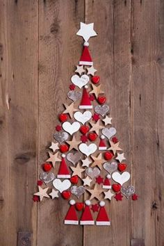 Photo about New design for a christmas tree - red and white decoration for xmas on a wooden brown background. Image of greetings, noel, colored - 34585448 Diy Christmas Tree, Christmas Door, Xmas Tree, Christmas Projects, All Things Christmas, Christmas Holidays, Christmas Ornaments, Ornaments Ideas, Felt Ornaments