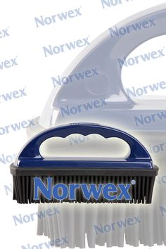 Norwex Rubber Brush (www.norwex.com) Use for Removing: * Pet hair  * Lint  * Human hair  * Dust * Dried-on dirt   For use on: Carpeted Stairs: Simply brush each stair to remove all hair. Norwex Dry Mop pads: Simply brush the debris from the microfiber cleaning mop pad. Fabric Furniture: Brush to pick up hair and to sweep crumbs from under cushions. Carpet: Fast and easy way to remove pet hair, dust, lint, and unwanted debris from carpeted surfaces.