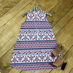 Adaline Tank Tunic/Dress is a summer essential! This simple, a-line style dress features a charming blend of paisley and floral prints.
