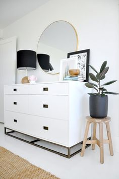House Updated modern white dresser white walls:  RH Teen White Dresser, Round Brass Mirror, Rejuvenation Lamp, Ikea Stool/Planter