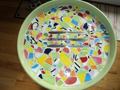 Fun mosaic table made with assorted dishes & butter knives