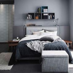 A grey bedroom with a grey ÅRVIKSAND divan bed, a grey TUSENSKÖNA bed spread and a grey FJÄRA storage box.
