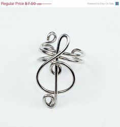 Holiday Sale - Silver Ear Cuff - Small Treble Clef. $5.95, via Etsy. I NEEEED.