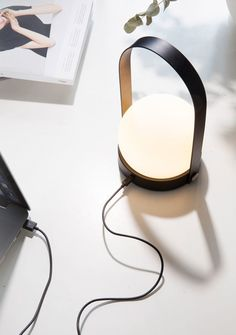 Carrie LED Lamp is a stylish, portable lamp from Menu, designed by Norm Architects. The lamp is a sequel to the popular Carrie vase, which has been Luminaire Design, Lamp Design, Light Design, Hygge, Modern Lighting, Outdoor Lighting, Portable Led Lights, Carrie, Chandeliers