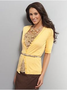 brown skirt with yellow cardigan over tan or beige print ruffle blouse<3