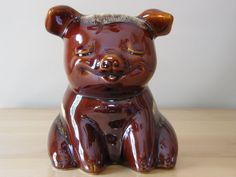 I actually own one of these. My brother gave it to me for Christmas when I was about 12 years old. Other than the cork on the bottom falling apart, he's still in excellent condition and sits on my dresser to this day. I'll never sell him but it's pretty cool to see he's worth something! Vintage Hull Pottery Corky Piggy Bank Model / by thetoadhouse via Etsy.