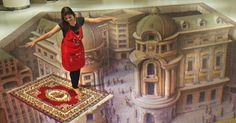 Essa mulher não está voando em um tapete mágico. A ilusão faz parte de uma exposição em 3D em Jacarta, na Indonésia