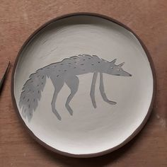 Wolfy plate #Work in process #Unfired #Sgraffito.