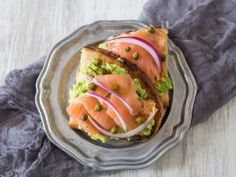 Avocado Lox Toast : <p><b>What You'll Need:</b>1 ripe avocado   1/2 lime   2 slices crusty toasted bread   2 large thin slices smoked salmon   small capers   sliced red onion</p>  <p></p>  <p><b>What to Do:</b>Cut avocado in half and remove the seed. Squeeze lime juice in each half of the avocado. Mash in its shell and spread over both slices of toast. Top with smoked salmon, capers and red onion slices.</p>