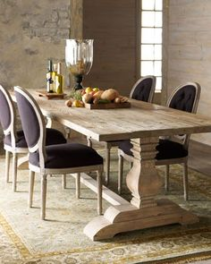 I'm kind of wanting to strip my dining table and do this. I love the chunky formal pieces with an informal finish.