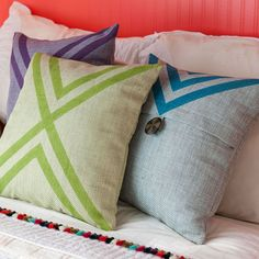 Three painted pillows on bed