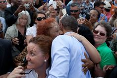 Audience members embrace President Obama in Tampa, FL