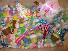 A birthday sensory bin.  A Great way to build a toddler's excitement of their special day!
