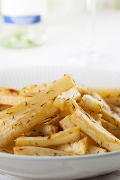 Rosemary Garlic Parsnip Fries- looks delish! I also spiralized them (it was a bit of a challenge) and cooked in coconut oil in cast iron skillet. Shredding might work to make 'hash browns' too